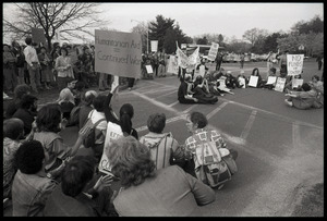 Protests against U.S. intervention in Nicaragua at Westover Air Force base: protesters seated on the pavement
