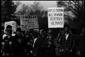 Protests against U.S. intervention in Nicaragua at Westover Air Force base: protesters carrying signs thanking Congress for refusal to support Contras and 'Stop US bombing in El Salvador: remember Vietnam'