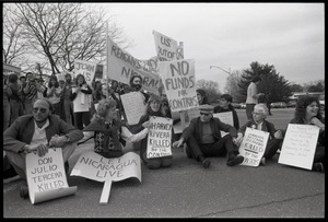 Protests against U.S. intervention in Nicaragua at Westover Air Force base: protesters seated on the pavement, including Frances Crowe (second from right)