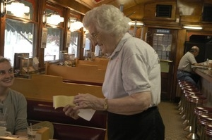 Waitress tending to customers at a booth, Miss Florence Diner