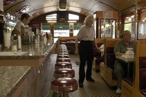 Waitress with customers at a booth, Miss Florence Diner
