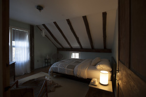 Sheffield House: interior view of a bedroom in a post and beam house, Sheffield, Mass.