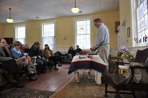 Aftermath of the Congregational Church fire in West Cummington, Mass.: pastor at a makeshift altar