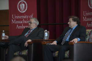 Congressman Barney Frank and author Stuart Weisberg seated on the Student Union Ballroom stage, UMass Amherst, during their book event