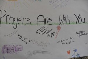 Aftermath of the Congregational Church fire in West Cummington, Mass.: sign on the wall reading 'Prayers are with you'