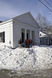 Aftermath of the Congregational Church fire in West Cummington, Mass.: exterior view of parishioners approaching the Parish House