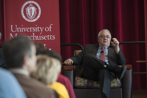 View from the audience of Congressman Barney Frank seated on the Student Union Ballroom stage, UMass Amherst, during his book event