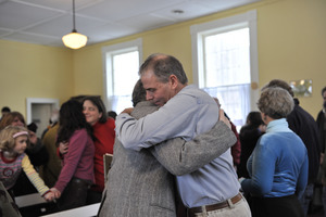 Aftermath of the Congregational Church fire in West Cummington, Mass.: emoitonal parishioners hugging one another