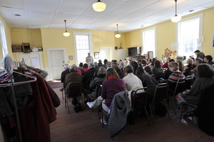 Aftermath of the Congregational Church fire in West Cummington, Mass.: parishioners gathered for worship inside the Parish House