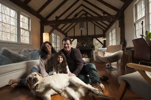 Sheffield House: Martin Canellakis, Faith Cromas, daughter Eva, and dog Poppy in their living room, Sheffield, Mass.
