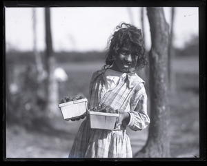 Young girl with just-picked strawberries