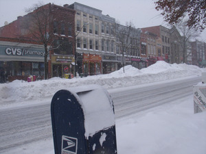 View looking west of deep snow piles in the middle of Main Street, Northampton, Mass.
