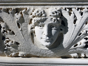 Dickinson Memorial Library: detail of classical face carved in frieze