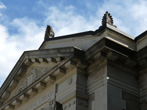 Griswold Memorial Library: detail of pediment and ornaments above front door