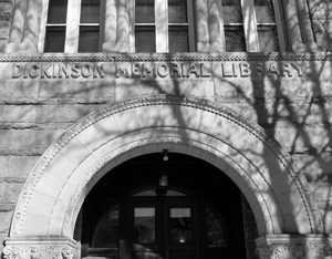 Dickinson Memorial Library: front entrance with shadow of a tree