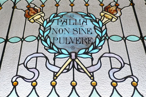 Dickinson Memorial Library: close-up of stained glass window 'Palma non sine pulvere'