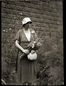 Agnes Carr, 'Boston Traveler Poetess,' with bouquet of flowers
