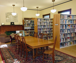 Buckland Public Library: interior seating area, tables, and bookcases