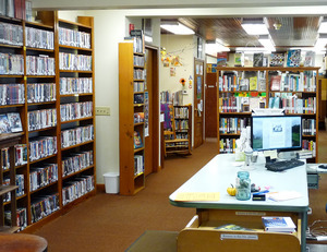 Heath Free Public Library: interior with reading area and book stacks