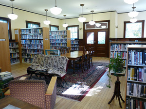 Buckland Public Library: interior view of casual seating area and bookcases