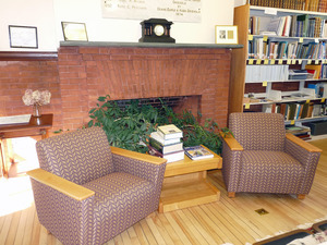 Buckland Public Library: interior view of casual seating by the fireplace