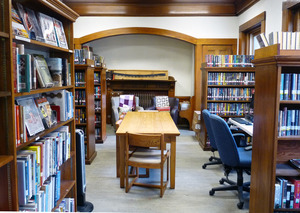 Tyler Memorial Library: interior view with tables and book stacks