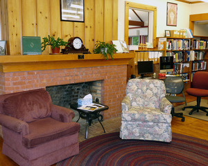 Rowe Town Library: interior view of seating by a fireplace