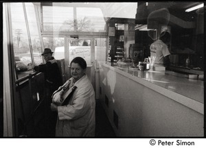 Customers at Joe Gile's Bungalow, a popular take-away restaurant in Lawrence: cook behind the counter is wearing a Joe Gile's jacket