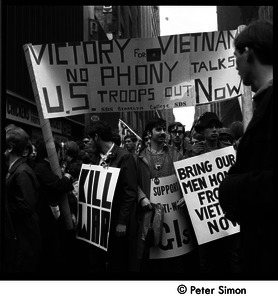 Antiwar demonstrators with banners 'Victory for Vietnam, no phony talks, US troops out now'