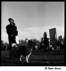 Man walking his dog at the Be-In, Central Park, New York City