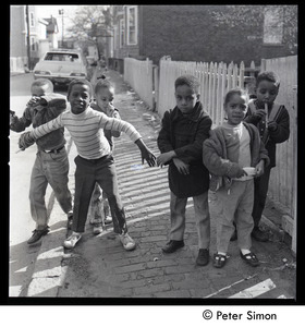 African American children playing in the street
