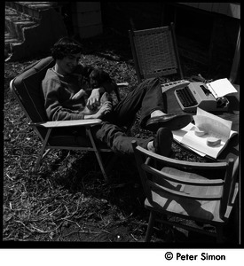 60 Chestnut Street: Stephen Davis seated in a lawn chair with puppy and typewriter