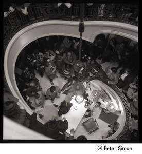 Antiwar protesters occupying University Hall, Harvard (?): looking down a stairway at occupying students and press
