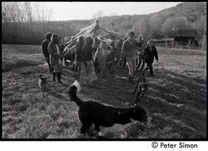 Revelers carrying the maypole into the field, Packer Corners commune