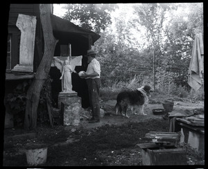 Carlo Abate, with pet dog outside his studio