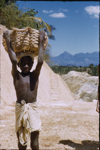 Boy carrying gravel