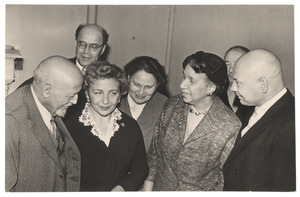 W. E. B. Du Bois and Shirley Graham Du Bois talking with unidentified men and women