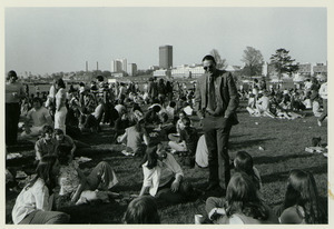 Randolph W. Bromery conversing with students, outside at student picnic