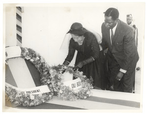 Unidentified minister of the Ghanaian government escorting Shirley Graham Du Bois laying a wreath at the graveside of W. E. B. Du Bois