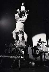 Chimpanzee vaudeville act opening for the Grateful Dead at Sargent Gym, Boston University: chimpanzee balancing upside-down with parrot