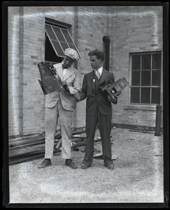 Jack Dixon (left) and unidentified colleague posed with their Graflex cameras