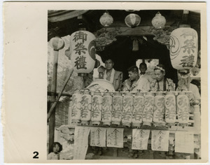 Close-up of men on a float in a matsuri procession