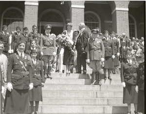 Amelia Earhart reception: Earhart, with bouquet of flowers, atop the steps of the Massachusetts State House