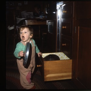 Baby with pans, Wendell Farm