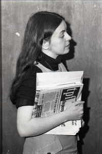 Bernadette Devlin McAliskey at the WBCN studios, holding copy of 'the people first'