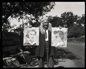 Albion L. Clough displaying paintings for sale by the side of a road