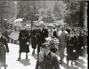Amelia Earhart reception: Earhart ascending the steps at the Massachusetts State House, acting Mayor Edward M. Gallagher to her right