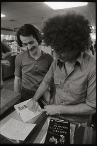 Abbie Hoffman signing a copy of Steal This Book