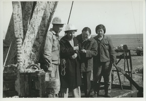 Shirley Graham Du Bois with two unidentified women and one man at an oil well