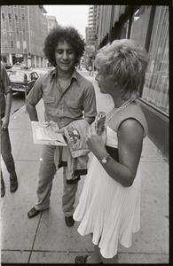 Abbie Hoffman talking to a woman on the street